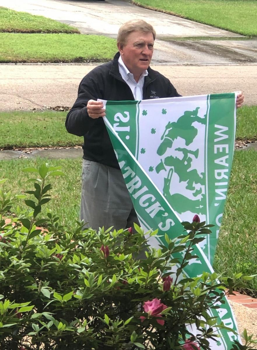 Pat Shingleton holding one of the 2019 Parade Flags